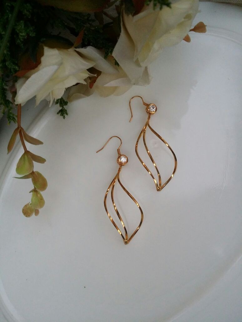 Beautifully craved golden earrings